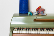 A blue lamp atop a green 1973 Rhodes electric piano