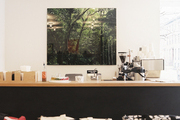 Landscape photography hung above a coffee bar