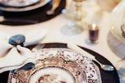 A dining table set with transferware