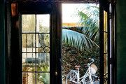 Intricate wrought iron detailing on an arched window at Palihouse Santa Monica