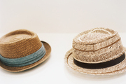Hats on a white shelf