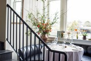 A curved banquette by a window at The Thomas restaurant in downtown Napa