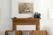 An original Hans Wegner sleeper sofa—which Villinger bought when she first moved to New York—in the living room.