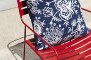 A brightly hued chair with a patterned pillow at Napa Valley's Poor House