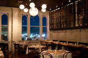 The dining room, with its floating wine cellar, at downtown Napa's The Thomas restaurant