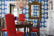 A blue-and-white pattern-filled dining room by BHDM Design.