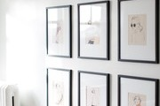 A gallery wall in a bedroom.