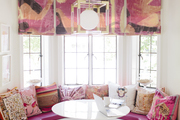 Here is a bright breakfast nook with lots of graphic pillows and color.