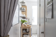 Pulled back curtains lead into a functional kitchen