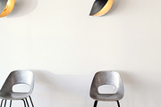 Chairs and wall art in a minimal retail space