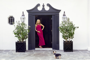 Molly Sims stands in the doorway of her  Beverly Hills home