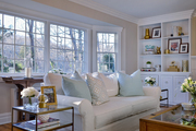 White and beige living room with blue pillows.