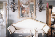 Sconces and chandeliers in a shop filled with antiques
