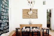 Upholstered stools surrounding a wooden table