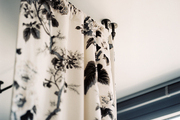 A floral bed canopy with industrial curtain rods