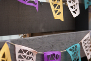 A colorful DIY papel picado banner decoration