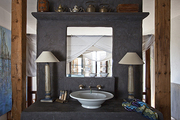 A freestanding concrete sink and vanity area in the home of Spanish artist Pepa Poch.