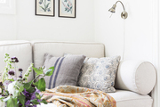 Patterned throw pillows atop white couch.