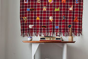 Eclectic patches turn this plaid blanket into a work of art.