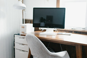 A workspace with a gray chair.