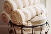 A metal basket of striped towels
