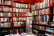 Books arranged on red shelves in a retail environment