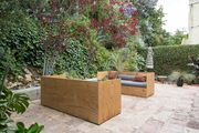 A contemporary outdoor space with wooden furniture.