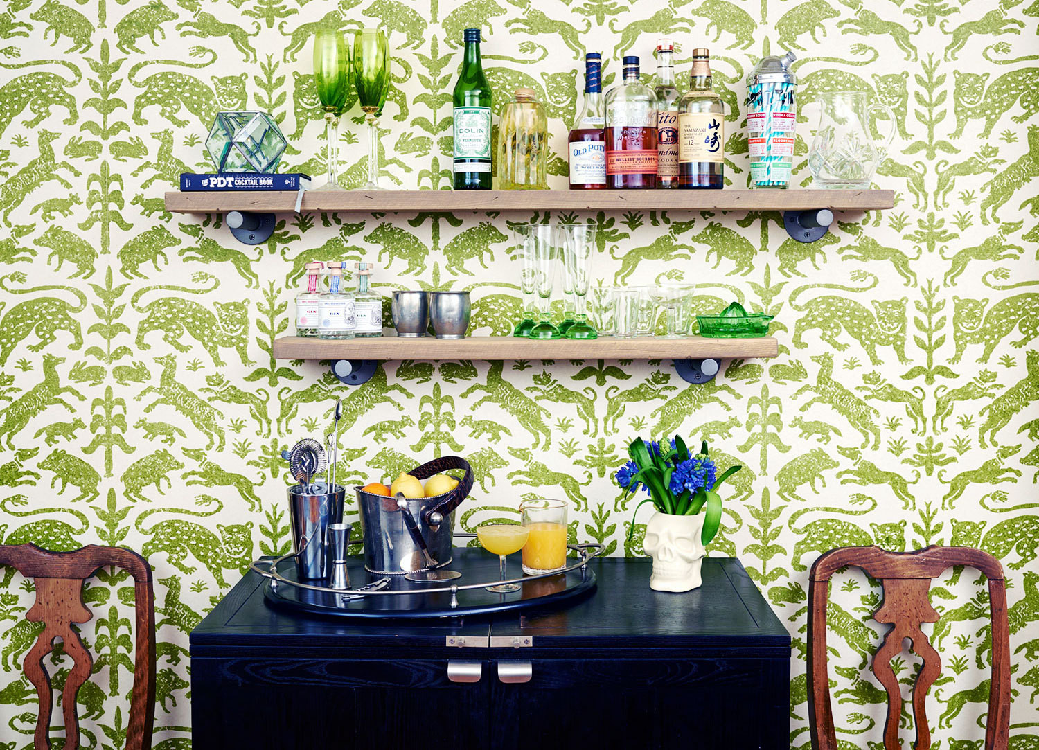 A Southern-inspired entertaining area in the kitchen of Studio Four NYC co-founder Kate Reynolds is backed by Pintura Studio's Escorial wallpaper. Photographed by Rachel Watson and Alexandra Strata