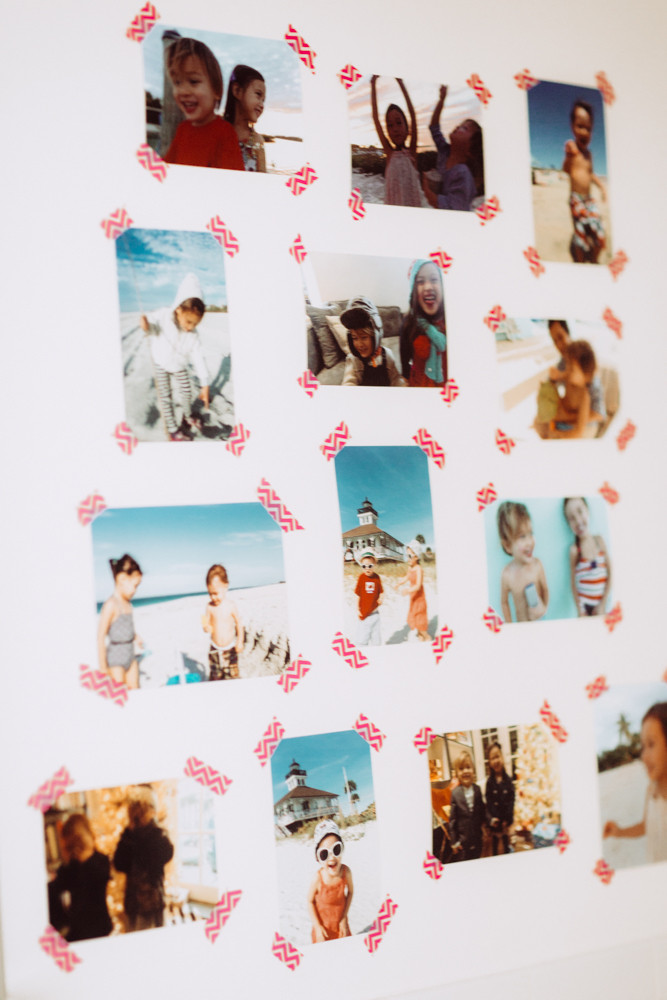 Create a casual gallery wall with washi tape and your favorite snapshots from family vacations.