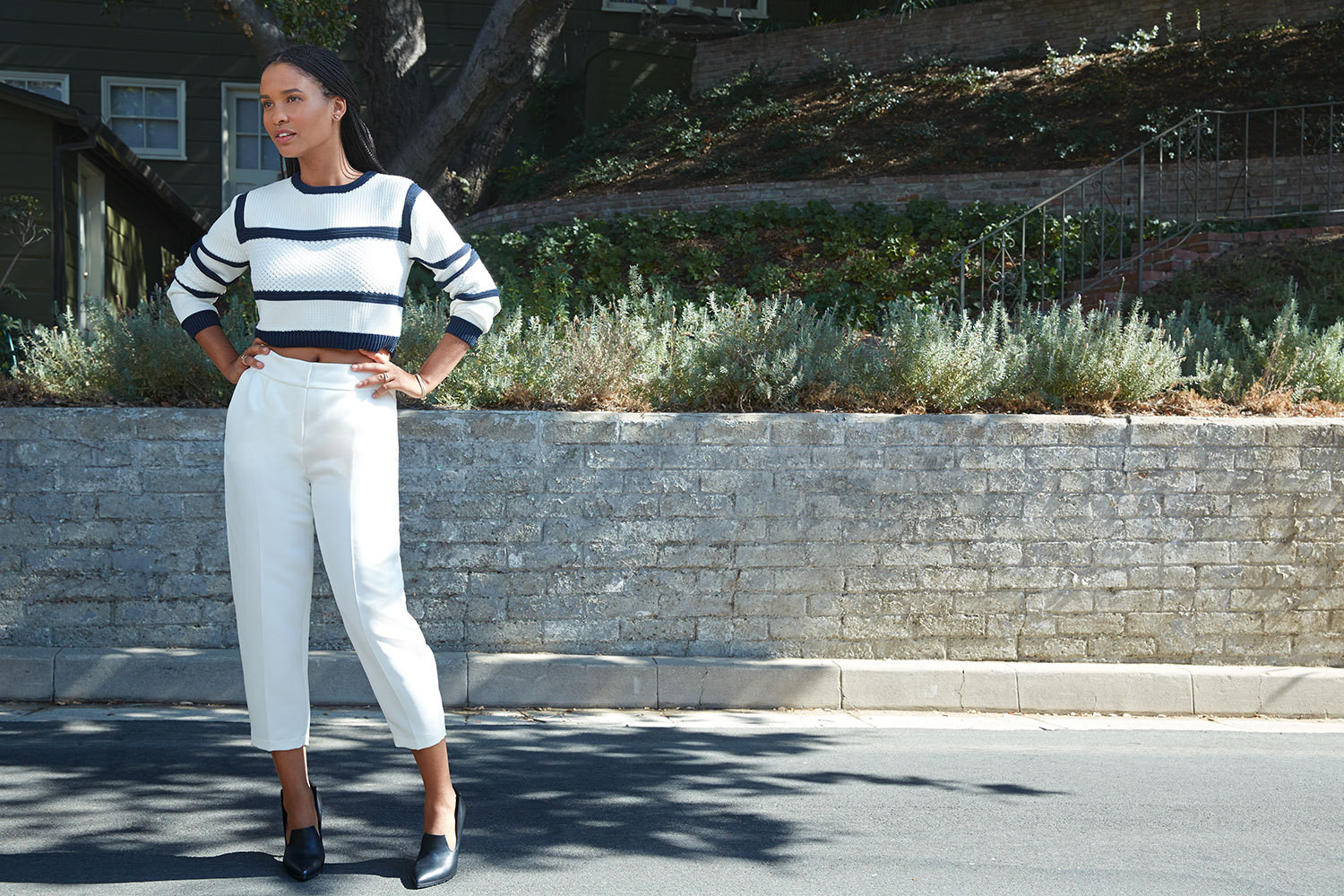 Actress Joy Bryant near her home in Glendale, California. Tibi sweater and Elisabetta Franchi pants; shoes by Greymer. Fashion styling by Jessie Cohan. Hair by Clariss Rubenstein at the Wall Group. Makeup by Gregory Arlt at Exclusive Artists Management. Prop styling by Joni Noe.
