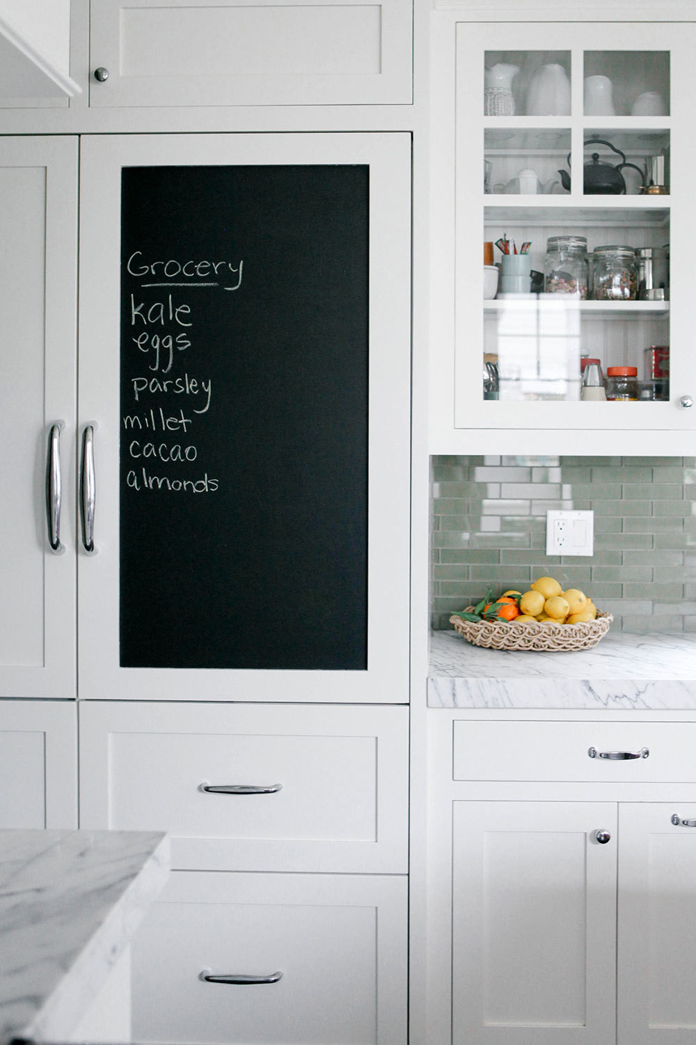 A chalkboard panel serves as message central.