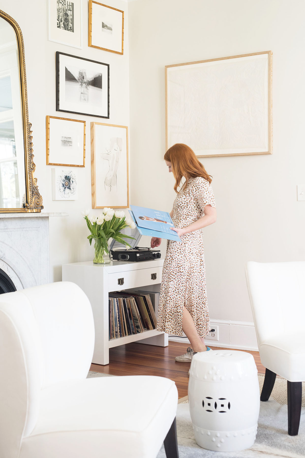 The couple spend their downtime entertaining at home, or listening to records in the traditionally southern sitting room.Crosley Record Player |Worlds AwaySide Table |Wayfair Stool |Scott Antique Market Armchairs, upholstered inSchumacher Linen.