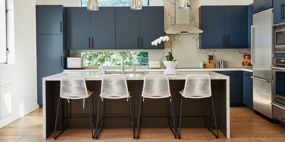 This sleek, modern kitchen is the heart of the home and where you'll find the family most of the time.Modloft Barclay Counter Stool |Smeg toaster |Brightland Awake Olive Oil |Jonathan AdlerVice Secrets Canister.