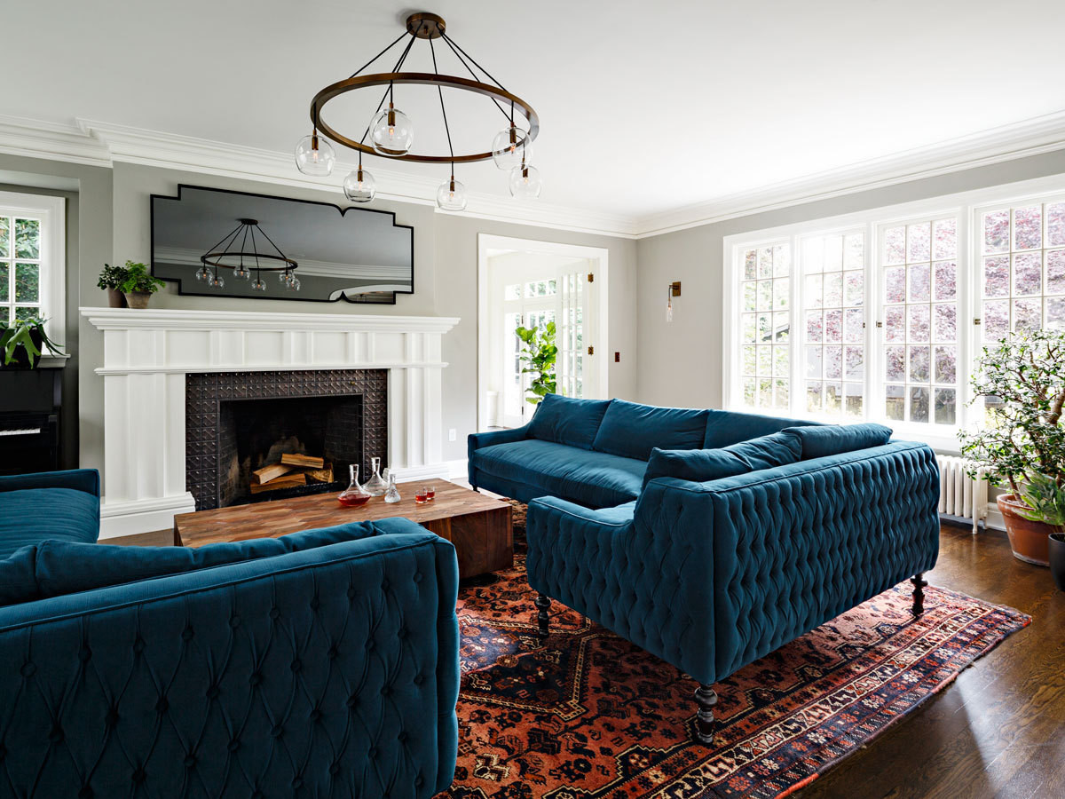 Velvet-upholstered sofas designed by Helgerson and her team introduce lush jewel tones into the space.