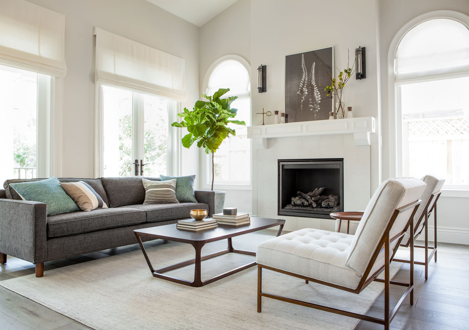 The living room that jennifer jones designed in palo alto california features sustainably minded