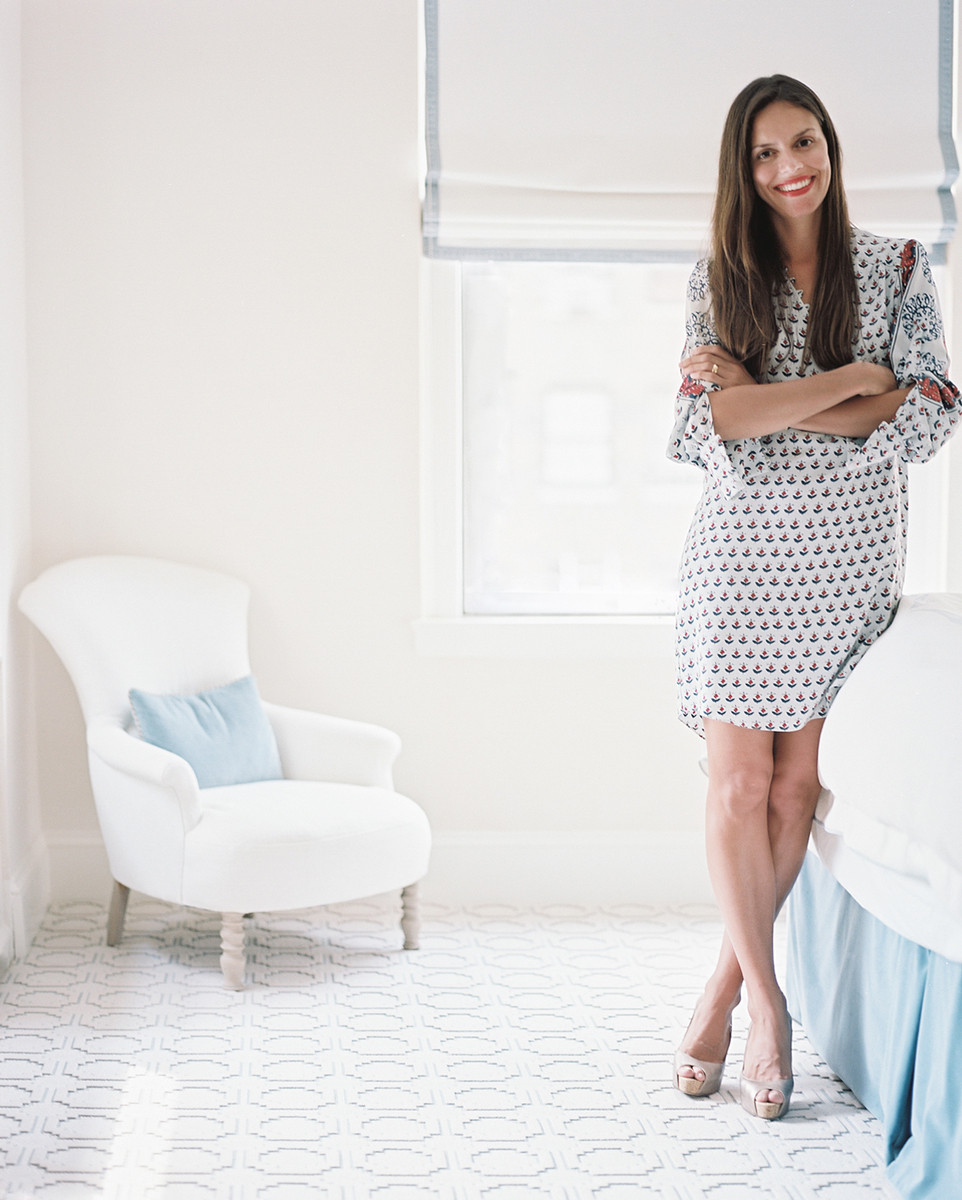 Designer Lilly Bunn Weeks in a sunny bedroom in the uptown apartment she designed for her clients.