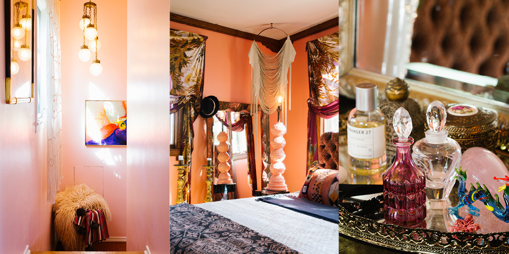 "A sweet staircase is elevated with delicate pendant lighting and family paintings. A basket at the top of the stairs holds her favorite throw blankets, a hint at the master suite beyond. Patterned fabric winds around the windows. ""When you close the drapes, sort of let them fall, the light hits through them. It's super magical."" Glass and brass bottles and beauty items add to the glamorous glow."