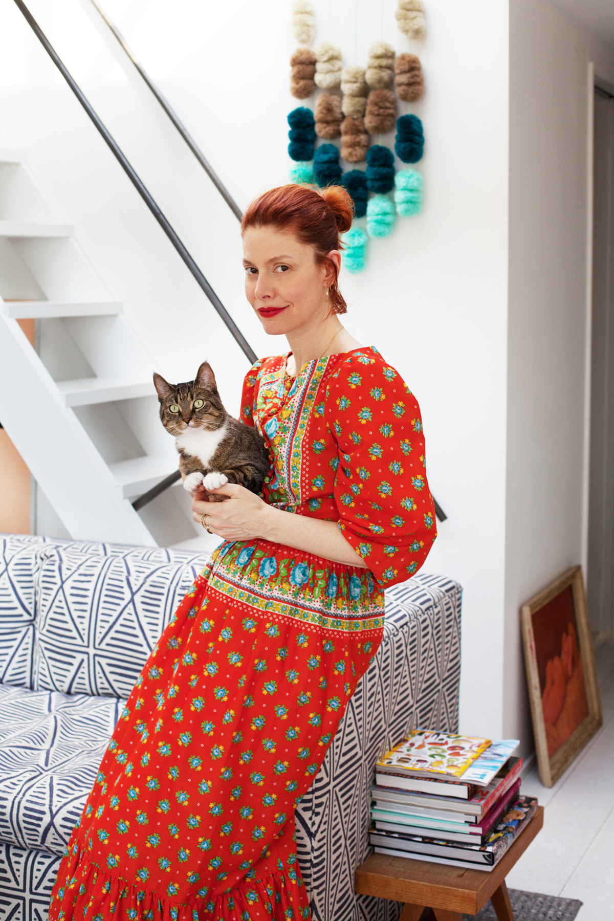 Refinery 29 co-founder Christene Barberich sits at home with her cat Phoebe.