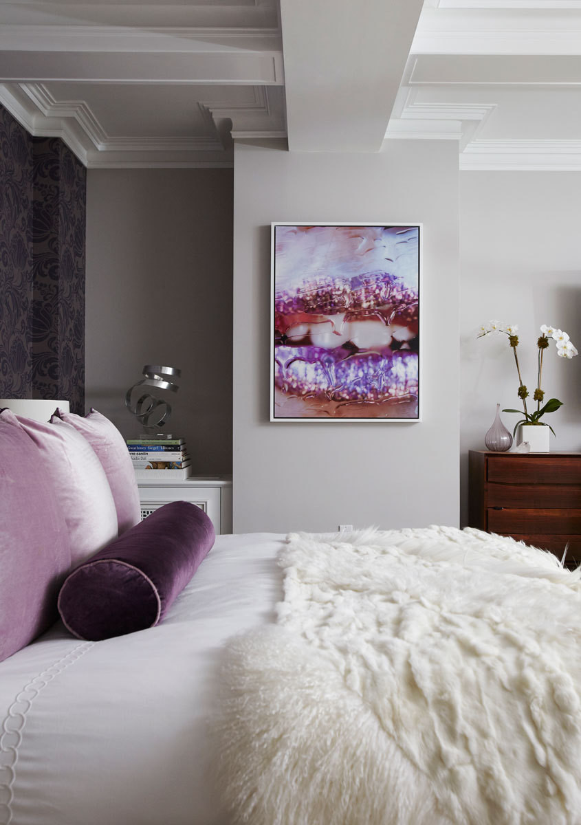 Deeper colors, like the icy purple lips in a Marilyn Minter print, inspired the bedding and overall tones in the master bedroom.