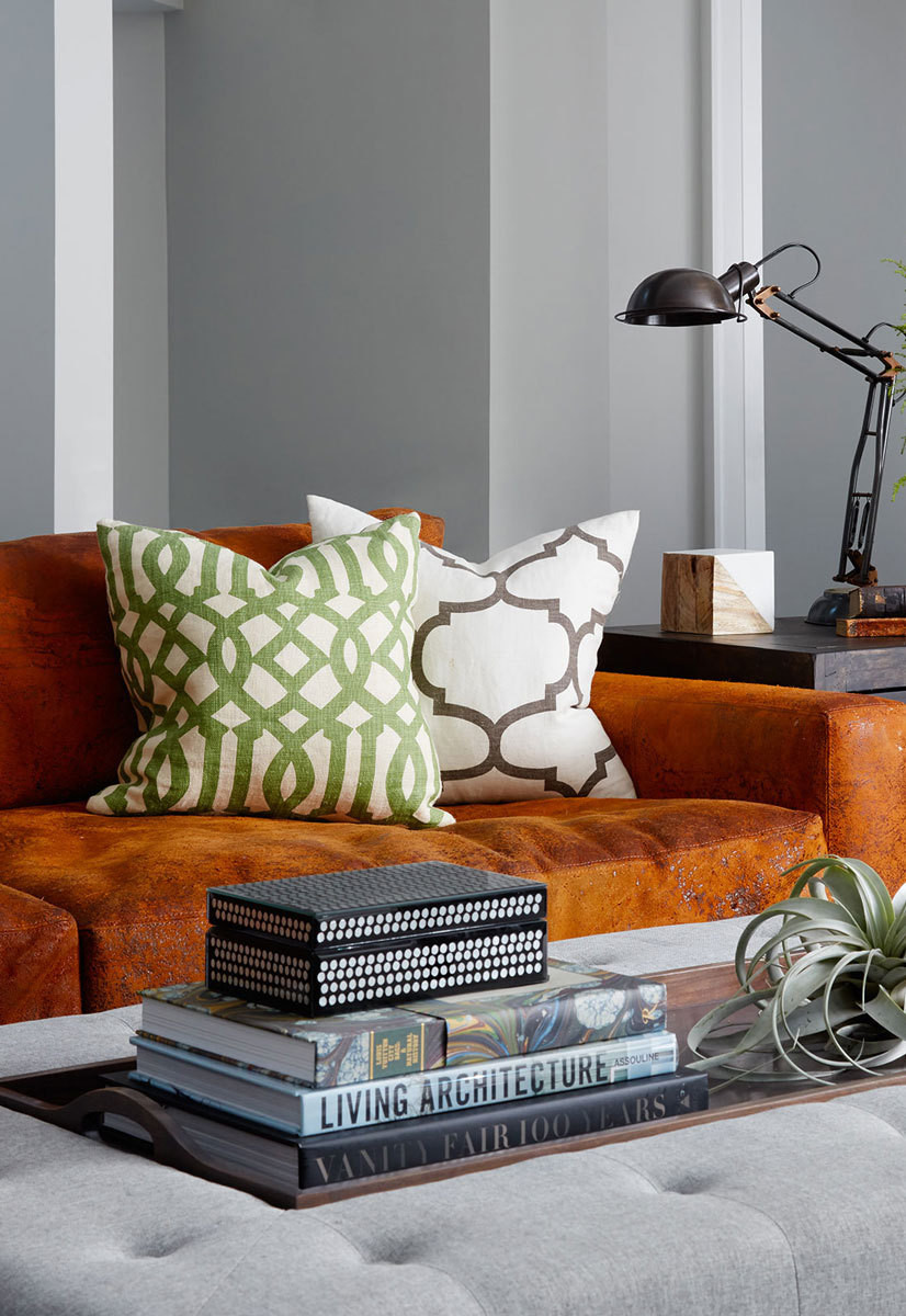The oversize ottoman in the family room was custom and designed with the couple's three kids—all under two—in mind.