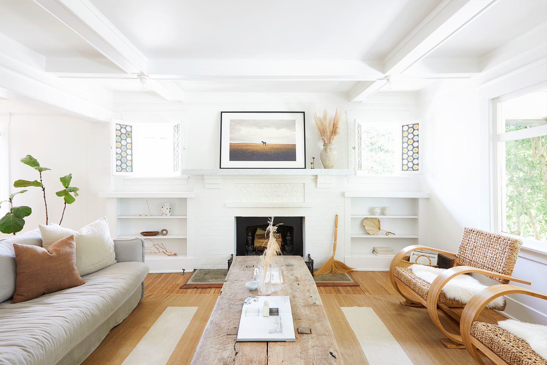 A warm-yet-minimal bungalow in Venice Beach gets an earthy edit. Dunn Edwards Paint | Sixpenny Sofa | Vintage Rug | Vintage Custom Coffee Table | Vintage Artwork | Hawkins New York Sheepskins | Alvar Aalto Assorted Glass Vases | Rachel Saunders Ceramics | Vintage Candlesticks | General Store Basket.