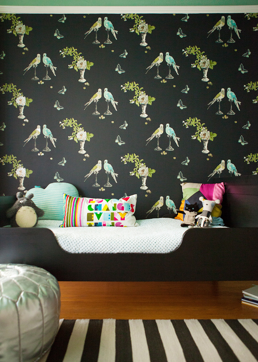 Georgia's bedroom combines Nina Campbell's playful Perroquet wallpaper and a mint-green ceiling.