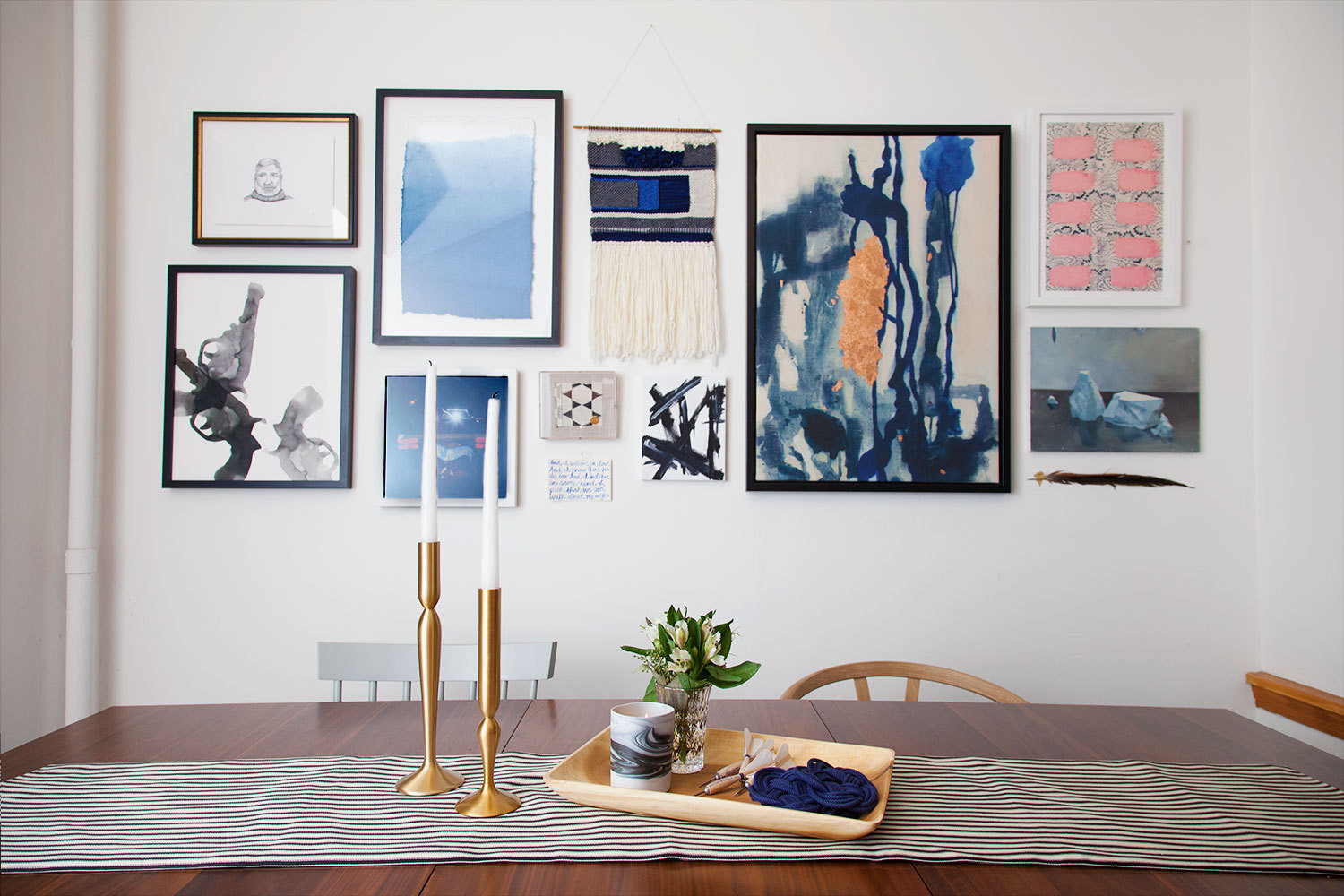 Market editor Cat Dash's dining room revamp; a set of Calvin Klein candlesticks sits on a Loom Decor striped runner.
