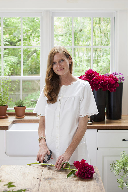 Interior designer Elizabeth Cooper in the kitchen of Blythe and Mark Harris's home in Sag Harbor.