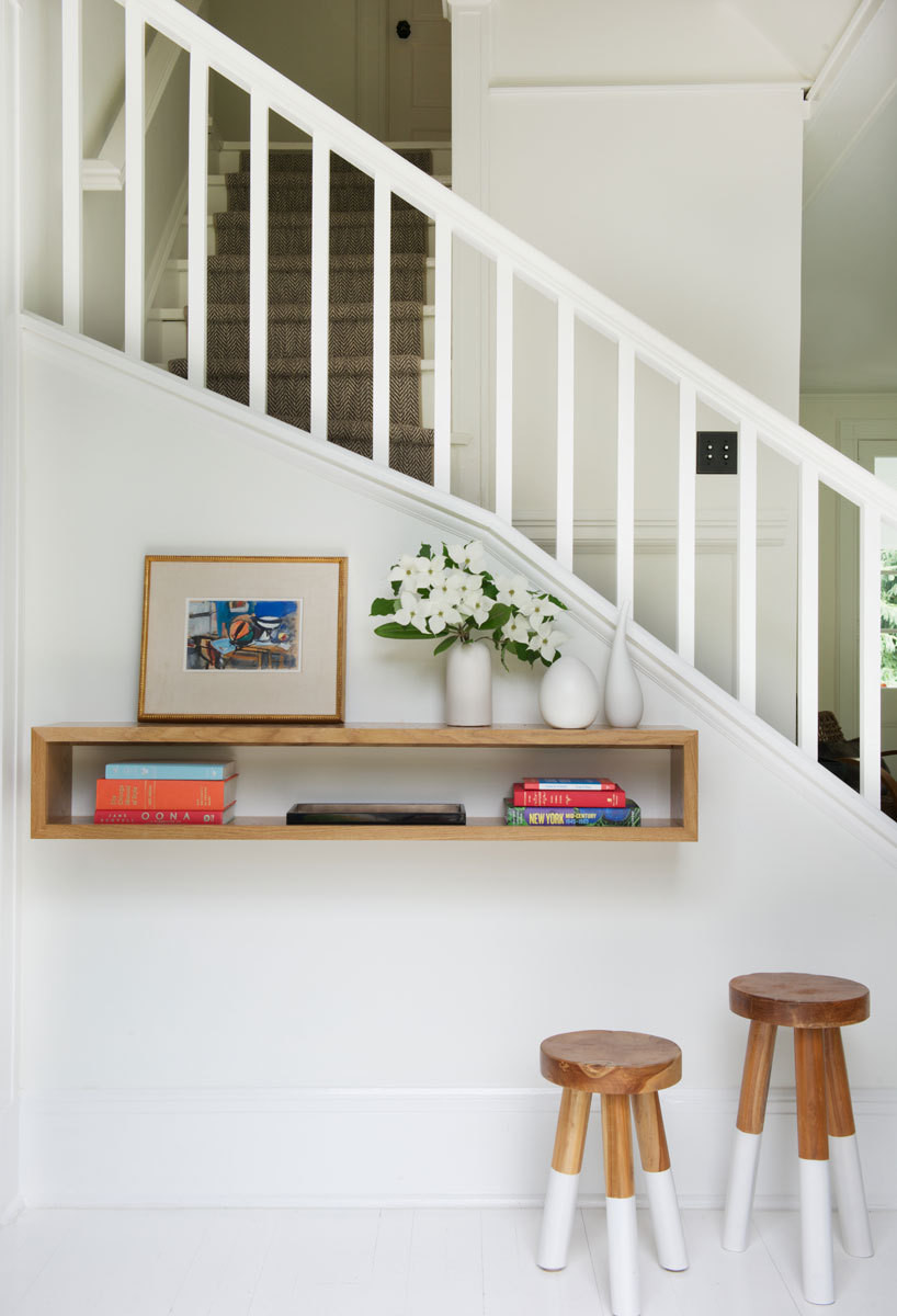 A floating shelf functions as an elegant drop zone in the relatively petite entry.