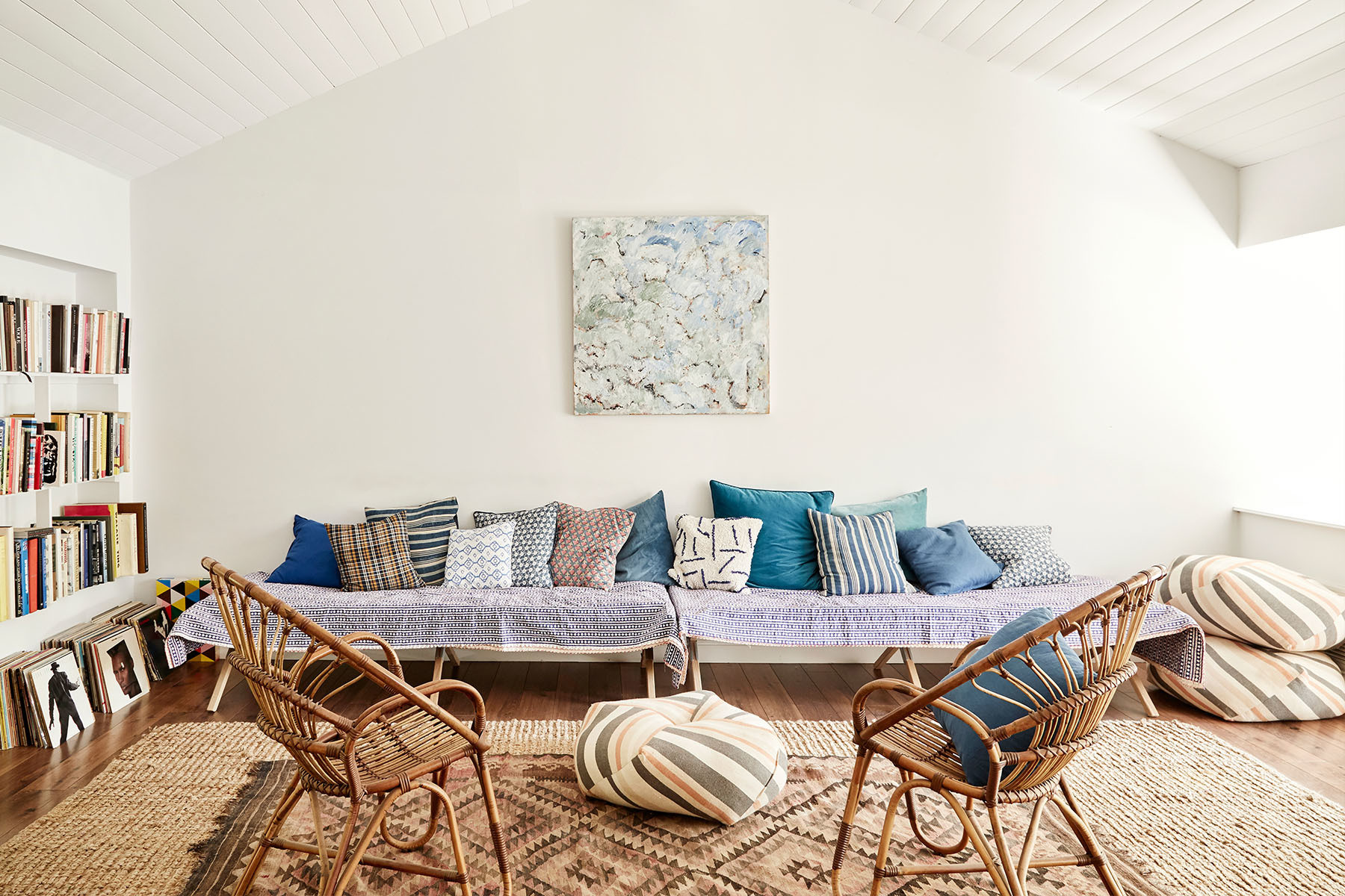 Peaked Tudor ceilings are now painted gallery white. Vintage Army Cots | Kantha Quilts | Urban Outfitters Ottoman | Serena & Lily Armchairs | eBay Vintage Rug | Mary Phillips Artwork.