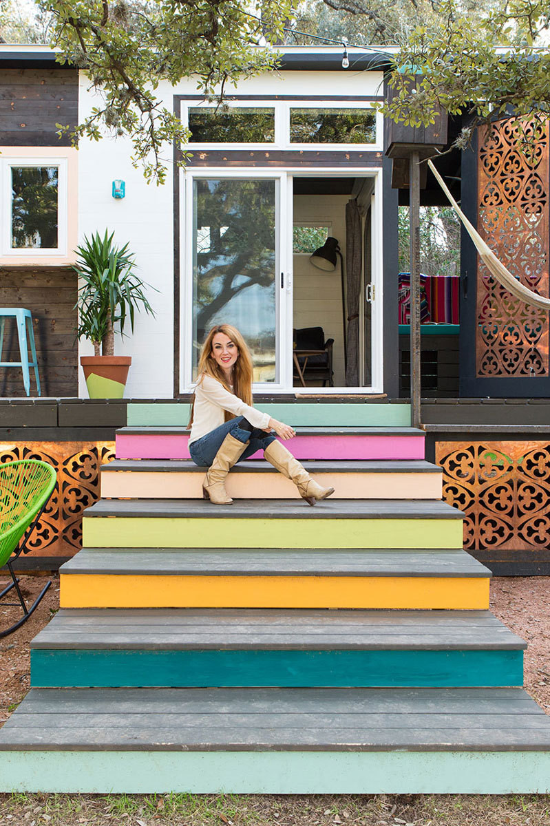 Designer Kim Lewis on the home's colorful, extra-wide steps, which double as additional seating for outdoor entertaining.