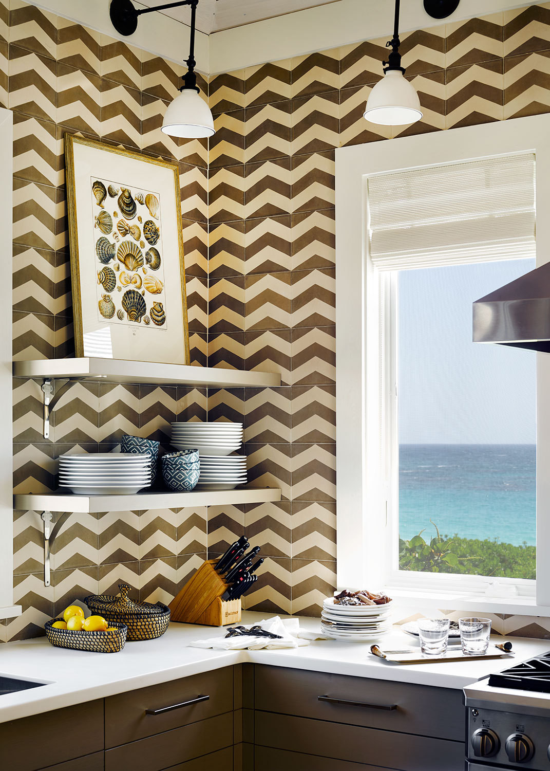Chevron wall tile sets off the kitchen's open shelving.