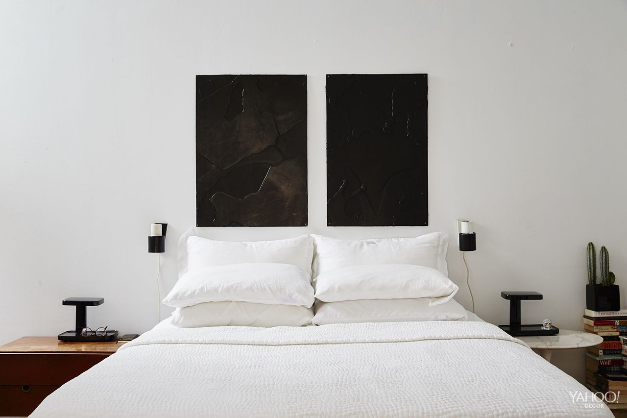 Minimalism rules in Leandro's black-and-white bedroom.