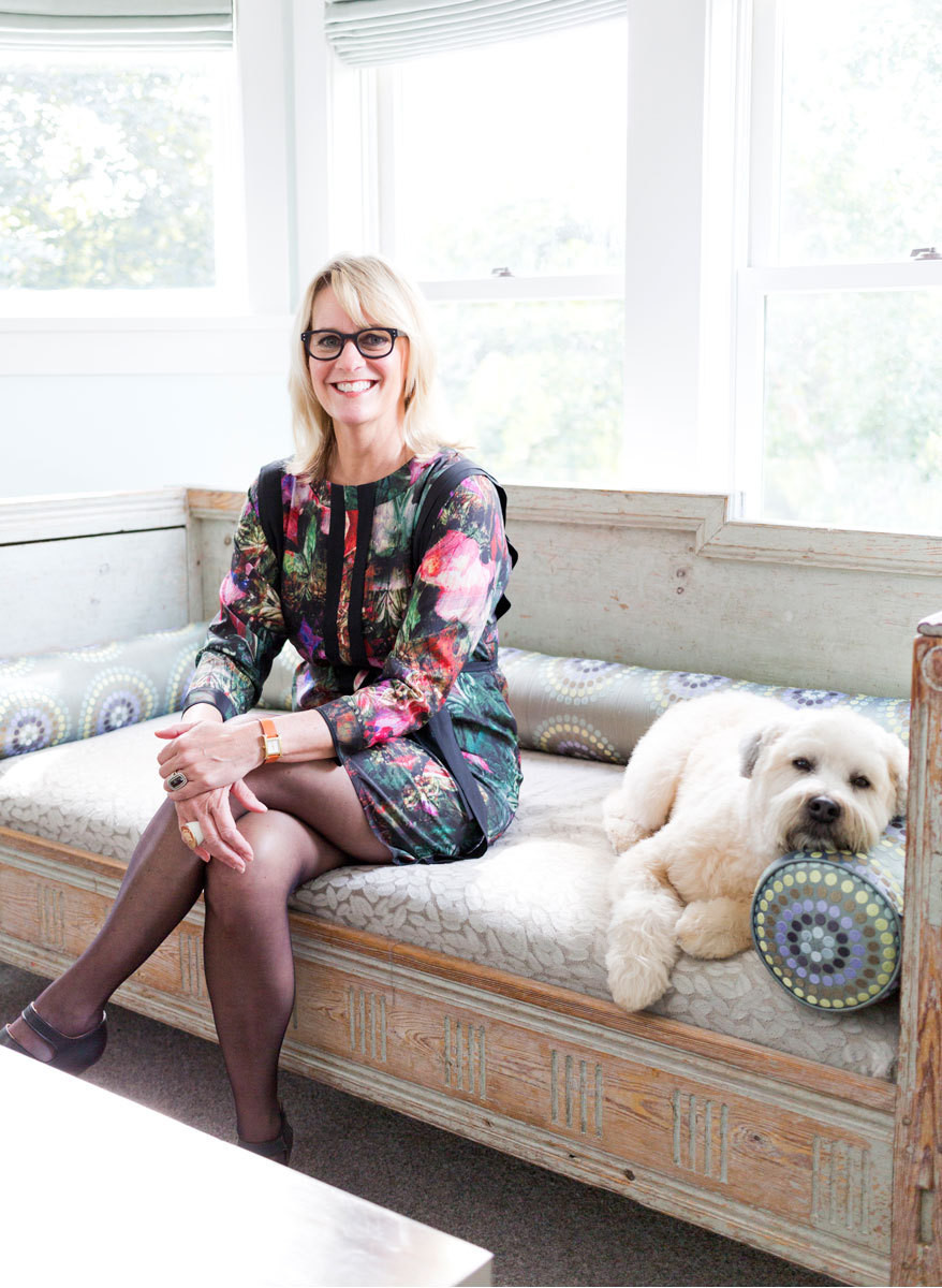 Julia Buckingham and pup look at home on a Gustavian daybed inher master suite.